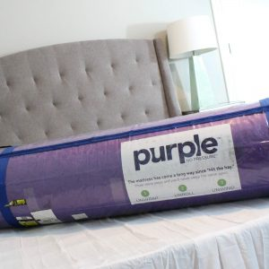 rolled-up-purple-mattress
